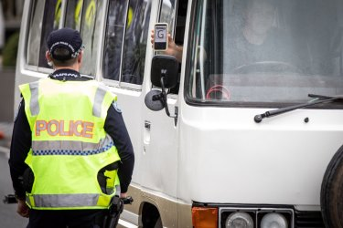 Police check cars for permits at a checkpoint in Coolangatta on Friday.