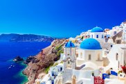 satsep9shippingnews Shipping News Cruise Column Brian Johnston Oia town on Santorini island, Greece. Traditional and famous houses and churches with blue domes over the Caldera, Aegean sea