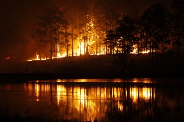 Hillville fire reflects on water during NSW bushfire emergency. 12 November 2019. Photo Dean Sewell