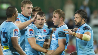 Bum taps all round: NSW celebrate what they hope will be a season-defining win against Melbourne