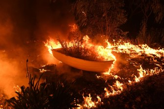 A small rowboat burns on the water at Failford during the Hillsville fire.