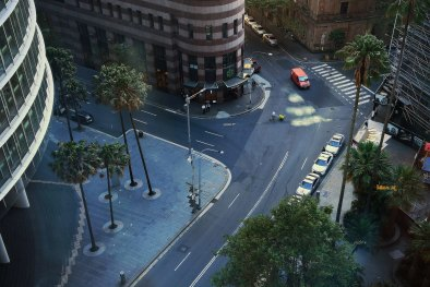An aerial view of a man pushing a trolley across a near empty Bent street in the CBD of Sydney. Scope economists argue that after the virus restrictions pass, governments will have to look at stimulus to re-boot the economy.