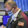 Wall Street fades late, 'meme' stocks swing again