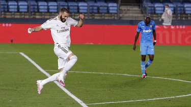 Karim Benzema celebrates his spectacular goal in Real Madrid's 3-0 dismantling of Valencia.