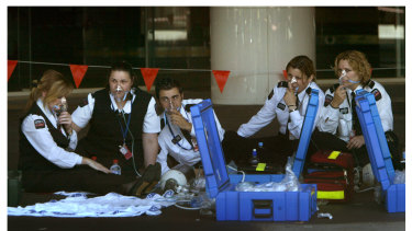 Melbourne Airport staff breathing with oxygen masks.