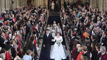 The star-studded congregation watch the pair walk down the aisle after they were married in St George's Chapel.