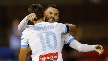 Kosta Barbarouses celebrates with the architect of his goal, Milos Ninkovic.