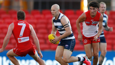 Good touch: Geelong's Gary Ablett in action against Sydney at Metricon Stadium on Sunday.