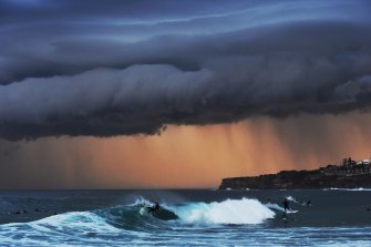 Surfers ride big waves along the Sydney coastline in November 2015.