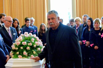 George Halvagis, father of Mersina, touches the coffin of Doncaster teenager Masa Vukotic at her funeral in 2015.