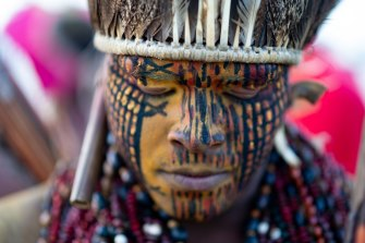 A member of an indigenous community joins a demonstration for indigenous land rights in Brasilia, Brazil, on Wednesday.