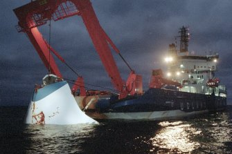 The bow door of the sunken passenger ferry Estonia is lifted up from the bottom of the sea, in 1994.