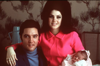 Elvis Presley with his wife Priscilla and their only child Lisa-Marie in 1968.