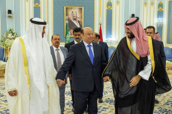 Yemen's President, Abed Rabbo Mansour Hadi (centre) is accompanied by Saudi Arabia's Crown Prince Mohammed bin Salman (right) and Dhabi's crown prince, Mohammed bin Zayed Al Nahyan before signing a power-sharing deal in Riyadh, Saudi Arabia, in November.