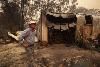Rob Meggs inspects his shed after the Wrights Creek fire swept through Kyola Rd on the outskirts of Kulnura, west of the Central Coast.