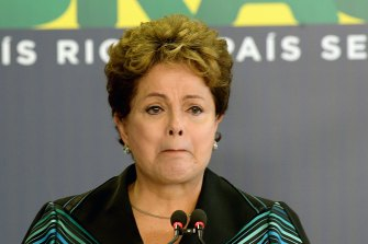 Brazilian President Dilma Rousseff cries while delivering a speech during the ceremony presenting the final report of the National Truth Commission.