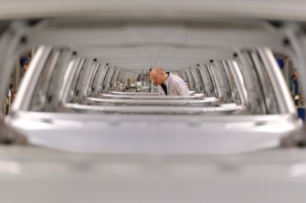 A worker is seen through the bodies of the ID.3 electric car at Volkswagen's Zwickau plant.