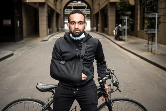 Korey Penny, pictured in September last year, is suing over alleged police brutality after he was arrested while riding to work on St Kilda Road.