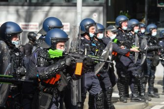 Police fire rubber bullets at protesters near Victoria Market on Saturday.