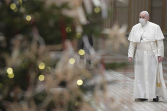 Pope Francis arrives to deliver the Urbi et Orbi message on Christmas Day.