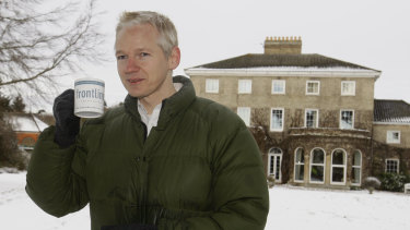 Julian Assange takes a drink during a press conference at the home of Frontline Club founding member Vaughan Smith in England in 2010. The leaks embarrassed Washington.