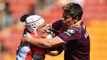 Heather Ballinger (right) tackles the Dragons' Teina Clark during their NRL Women's Premiership match.