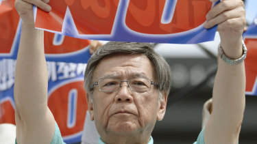 Then Okinawa Governor Takeshi Onaga shows off a banner reading 'No, new US base at Henoko', during a rally in 2015. He died of cancer last week.