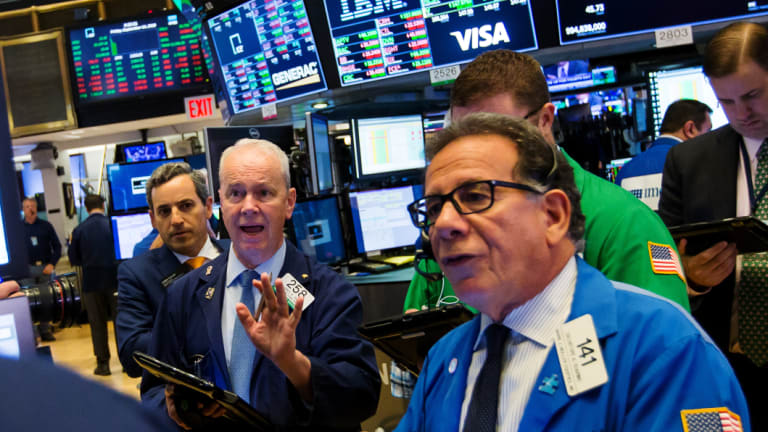 Traders on the floor of the New York Stock Exchange on Friday. Stocks rose for a fifth consecutive day, thanks to gains in the financial and information technology sectors.