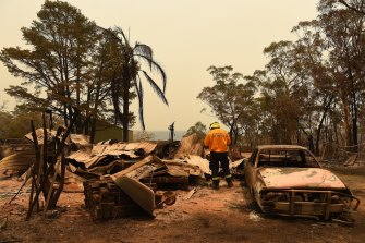 RFS assessors at a burnt out home at Balmoral