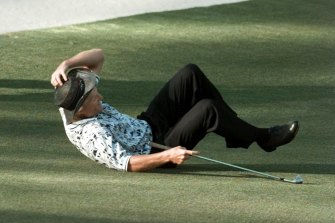 Greg Norman falls to the ground after missing his shot for an eagle at the 15th hole of the final round in 1996.