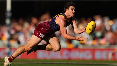 Lending a hand: Brisbane's Brownlow Medal favourite Lachie Neale in action against the Saints at The Gabba on Sunday.