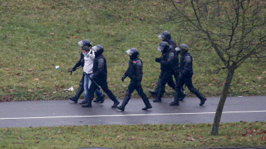 Belarusian riot police detain a demonstrator during an opposition rally to protest the official presidential election results in Minsk, Belarus.