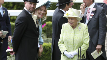 Loves her racing: Queen Elizabeth II right talks to her grandson, Peter Phillips, left and his wife, Autumn, during day five of Royal Ascot last weekend.