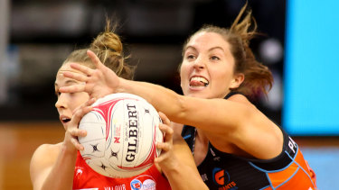 Maddie Hay of the Giants attempts to steal possession from Paige Hadley at Netball SA Stadium.