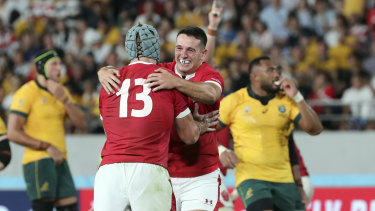 Wales players celebrate their thrilling win over Australia on Sunday.