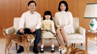 Naruhito, Masako and Princess Aiko with their dogs, Pippi and Mari, in 2007.
