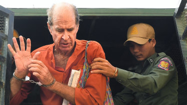 James Ricketson, who is accused of espionage, exits the prison van as he arrives at the Phnom Penh Municipal Court  for a court appearance.