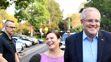 Prime Minister Scott Morrison and wife Jenny speak to the media as they arrive at the Horizon Church in Sutherland, Sydney, on Sunday.