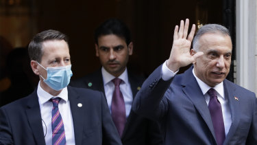 Trying to root out Iranian influence: Prime Minister of Iraq, Mustafa al-Kadhimi, right, waves to the media as he leaves Downing Street after a meeting with Britain's Prime Minister Boris Johnson in London.