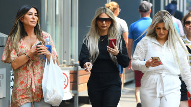 Brittany McGuire (right) and her friend Shanae Pericic (centre) arrive at Melbourne Magistrates Court on Tuesday.