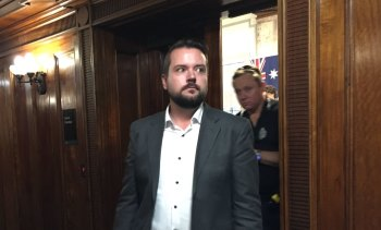 Queensland police remove Jared Cassidy from council chambers.