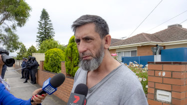 Armagan Eriklioglu, the father of two men arrested on terror charges, speaks to media outside his home.