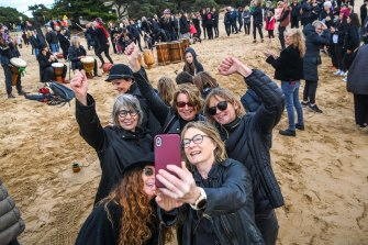 Women's March 4 Justice in Torquay. Participants take a defiant selfie with fists raised.
