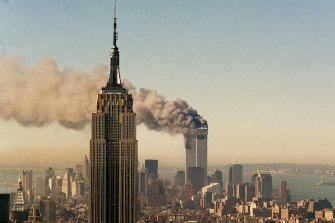 The twin towers of the World Trade Centre burn behind the Empire State Building in New York, after the terrorist attack of September 11, 2001.