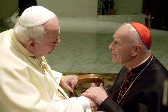 Then archbishop of Washington Theodore Edgar McCarrick, right, greets Pope John Paul II in 2001.