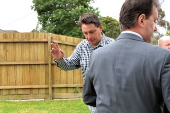 Racing Victoria's former chief steward Terry Bailey outside his house after shots where fired at his front door.