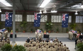 The ceremony at RAAF base in Amberley for Lance Corporal Stjepan Milosevic, Sapper James Martin and Private Robert Poate in September 2012.