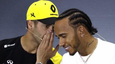 Renault driver Daniel Ricciardo chats with F1 championship leader Lewis Hamilton of Mercedes ahead of the British GP.