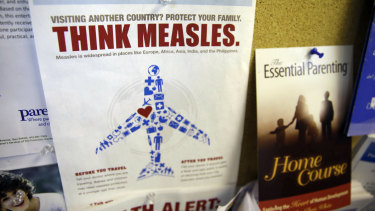 A flyer educating parents about measles is displayed on a bulletin board at a pediatrics clinic in Greenbrae, California.