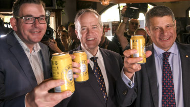 Opposition leader Bill Shorten and Premier of Victoria Daniel Andrews with former Premier Steve Bracks, toast the Labor legend with a Hawke's tinny.